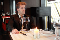 Young man in suit in a restaurant Stock Images