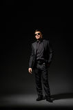 Young man in black suit and sunglasses Royalty Free Stock Image