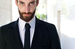 Young man in black suit and tie Royalty Free Stock Photography