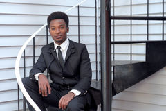 Young man black suit and tie sitting stairs businessman professional Royalty Free Stock Photo