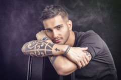 Young man with black t-shirt and tattoos Royalty Free Stock Photography
