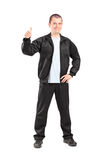 Young man in black tracksuit giving a thumb up Stock Image