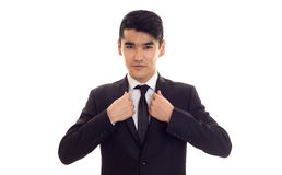 Young man in black tuxedo Stock Images