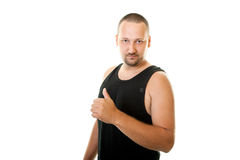 Young man in a black undershirt Royalty Free Stock Image
