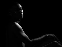 Young Man in Black and White. A dramatic black and white image of a young African American man Royalty Free Stock Photography