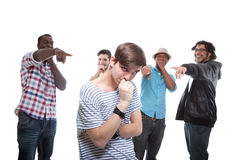 Young Man Blamed By His Friends Royalty Free Stock Photography