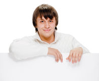 Young man with blank billboard Stock Image