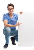 Young man with blank board. Young man over white background Royalty Free Stock Image