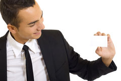 Young man with blank business card royalty free stock image