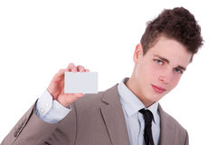 Young man with a blank business card in hand Royalty Free Stock Photography