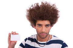 Young man with a blank business card in hand, Royalty Free Stock Image