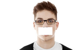 Young man with blank bussinesscard Royalty Free Stock Images