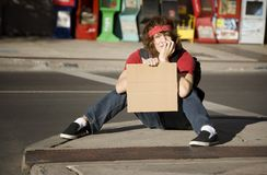 Young Man with Blank Cardboard Sign Stock Photography