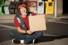Young Man with Blank Cardboard Sign Royalty Free Stock Images