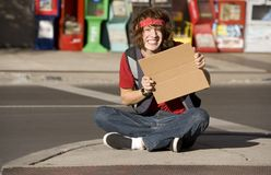 Young Man with Blank Cardboard Sign Stock Photo