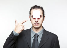 Young man with blank note on the face Royalty Free Stock Image