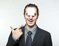 Young man with blank note on the face Stock Photo