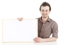 Young man with blank poster Royalty Free Stock Photography