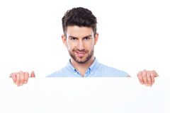Young man with blank poster Royalty Free Stock Photos