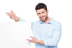Young man with blank poster Stock Photos
