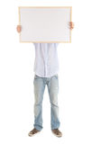 Young man with blank sign. White background Stock Photo