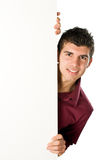 Young man with blank sign stock images