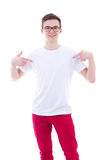 Young man in blank t-shirt pointing at himself isolated on white Stock Images