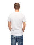 Young man in blank white t-shirt from back Stock Photos