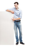 Young man by blank whiteboard Royalty Free Stock Photos