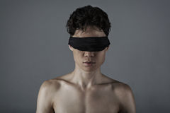 Young man  with a blindfold Royalty Free Stock Photography