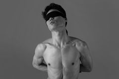 Young man  with a blindfold Stock Images