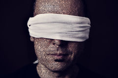 Young man with a blindfold in his eyes Royalty Free Stock Photography