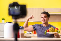 The young man blogging about food supplements. Young man blogging about food supplements stock images
