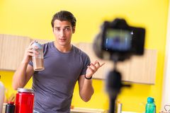 The young man blogging about food supplements royalty free stock photography