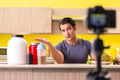 The young man blogging about food supplements. Young man blogging about food supplements stock photography