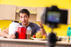 The young man blogging about food supplements. Young man blogging about food supplements royalty free stock image