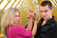 Young man and blonde in handcuff. Young man and the blonde in handcuff Stock Photos