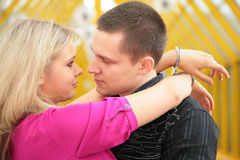 Young man and blonde in handcuff Royalty Free Stock Photography