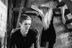 A young man and young blonde woman with long hair. Problems and difficulties in relations. Difficult situation in life. Conceptual. Black and white art Royalty Free Stock Images