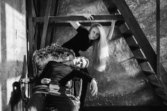 A young man and young blonde woman with long hair. Problems and difficulties in relations. Difficult situation in life. Conceptual. Black and white art Royalty Free Stock Photos