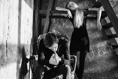 A young man and young blonde woman with long hair. Problems and difficulties in relations. Difficult situation in life. Conceptual. Black and white art Stock Photos