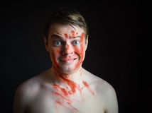 Young man with blood on his face. Royalty Free Stock Image