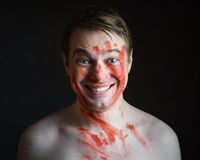 Young man with blood on his face. Royalty Free Stock Images