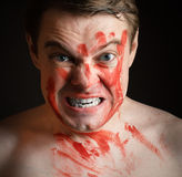 Young man with blood on his face. Stock Photo