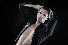 Young man with blouse taking shower Royalty Free Stock Photo