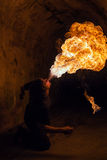Young man blowing fire from his mouth Royalty Free Stock Photo