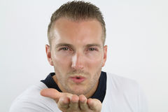 Young man blowing kiss Royalty Free Stock Photo