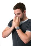 Young Man Blowing Nose Stock Images