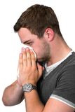 Young Man Blowing Nose Stock Photo
