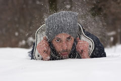 Young man blowing snow Royalty Free Stock Image